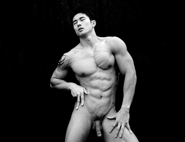 Asian guy posing in playgirl