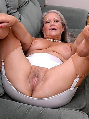 Fresh recommend best of Romanian chubby mature playing her tattoo pussy on bed.